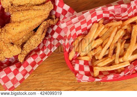 Fried Catfish Fillets And French Fries In Rural Cafe