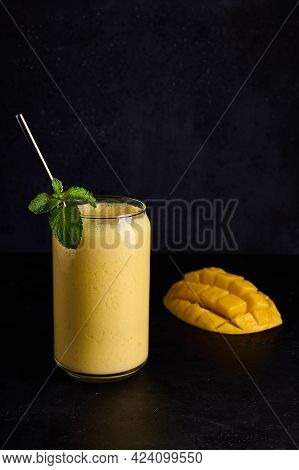 Lassi In Glass With Tube And Mango On Dark Background Vertical Orientation. Traditional Indian And P