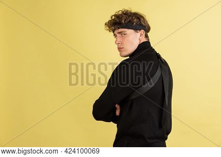 Portrait Of Sad Resentful Young Man In Standing And Looking At Camera With Dissatisfied Sadness Face