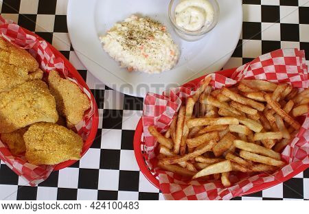 Fried Catfish With Coleslaw And French Fries In Rural Cafe