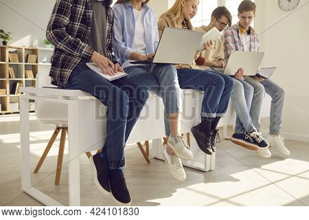 Middle Section Teenager Secondary Or High School Student Studying At Class