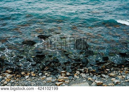 Beautiful Background Texture Of The Coastline Of The Sea Or Lake. Rocky Coast And Ocean Waves, Top V