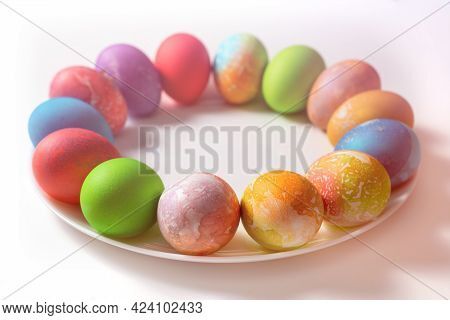 Painted Eggs For Easter On A Plate. Plate On A Brown Table. Eggs Lie In A Circle On The Plate.