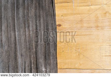 Close-up Of The Surface Of An Old Plywood Sheet. The Left Half Has A Gray And Uneven Top Layer. The