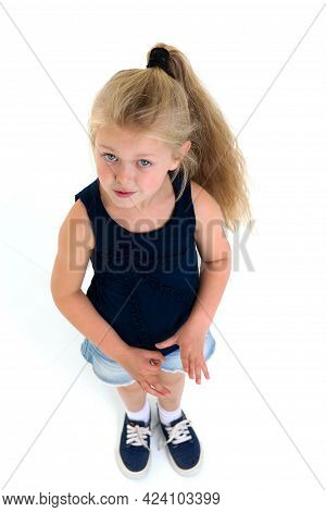 Top View Of Cute Six Years Old Girl. Happy Preschool Kid Looking At Camera Against White Background.