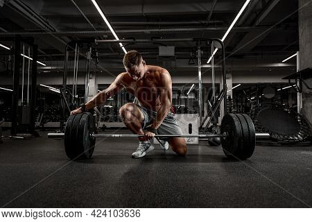 Athlete, Bodybuilder Exercise With A Barbell, Athlete Prepares The Barbell For Exercise, Beautiful B