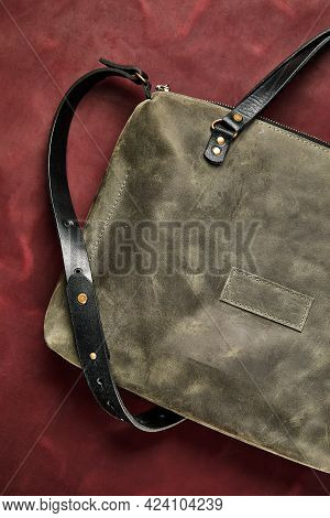 Leather Bag Made Of Gray Leather, Handmade On A Piece Of Burgundy Leather, Close-up