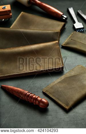 Leather Products Are Laid Out On The Masters Table, On A Piece Of Leather Among The Tools, Handmade