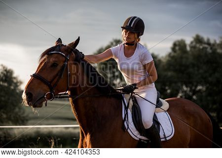 Young Woman Rides Horse In Background Of Nature. Sports And Health. Active Recreation. Enjoying Life