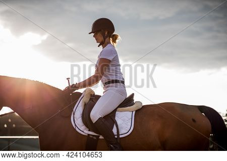 Portrait Of Young Rider In Profile Against The Sky.the Concept Of Healthy Lifestyle. Beauty And Spor