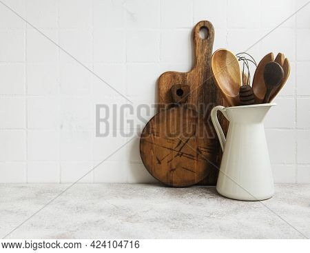 Kitchen Utensils, Tools And Dishware On On The Background White Tile Wall.