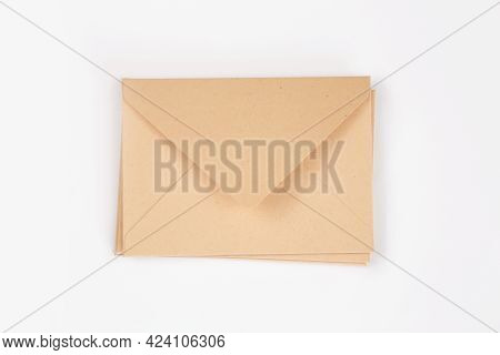 Stack Of Light Brown Paper Open Envelope On White Isolated Background. Three Craft Envelopes For Inv