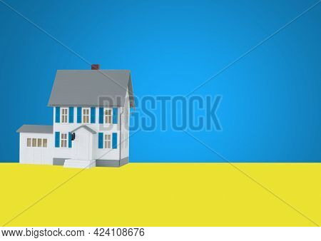 Composition of house on yellow ground and blue sky background. property, ownership and investment concept digitally generated image.