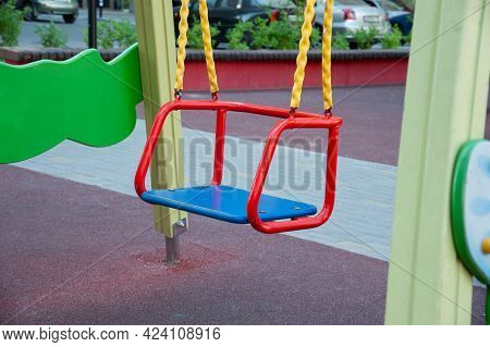 Empty Baby Swing With Backrest On A Sunny Summer Day