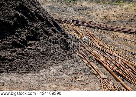 Stock Photo Of A Large Pile Of Black Construction Sand With Iron Or Steel Bar In Construction Site A