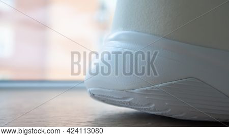 Low Angle View Of The Outsole Of The Back Of New White Sneakers. Rubber Sole On The Heel Of Men's Sh