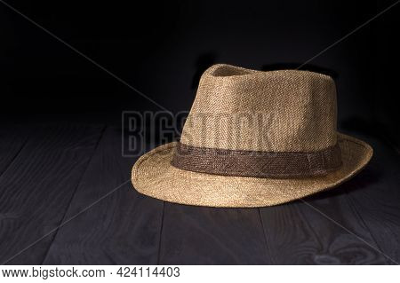 Classic Light Brown Summer Hat In Vintage Style On A Black Background.