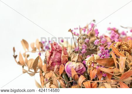 Close-up And Selective Focus Of A Dried Bouquet On White Background
