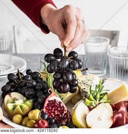 Woman preparing a cheese platter