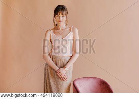 Casual woman in a nude tank top