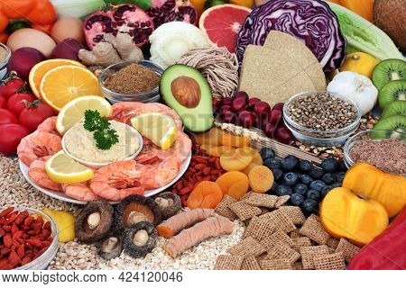 Health food for low cholesterol and low blood pressure diet high in antioxidants, protein, omega 3, vitamins, minerals, anthocyanins and fibre. Healthcare concept with large food collection.