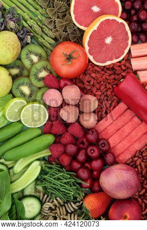 Green and red high fibre food for for good digestive health with fruit, vegetables and pasta. Foods also high in antioxidants, minerals, lycopene, smart carbs and vitamins. Health care concept.