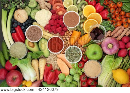 Health and well being vegan food for healthy eating very high in nutritional values with protein, omega 3, antioxidants, anthocyanins, vitamins, fibre, lycopene and smart carbs. Healthcare concept.