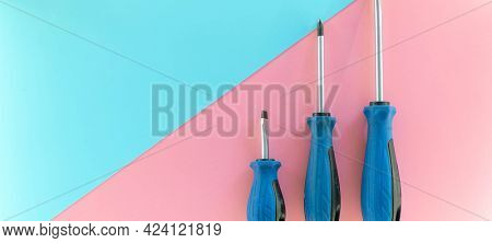 Screwdriver set, flat lay. Set of screwdrivers. Blue red background top view pattern copy space