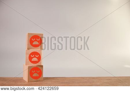 Sad Face Wooden Blocks In A Row. Customer Evaluation And Satisfaction Concept.