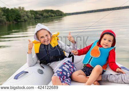 Two Cute Adorable Little Caucasian Sibling Boy And Girl Wearing Lifejacket Vest Having Fun Enjoy Rid