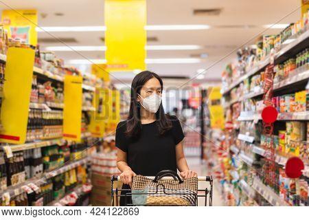 Woman In Face Mask Wearing Shopping In Supermarket During Coronavirus Quarantine