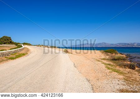 The Road On The Seafront In The Northeast Of The Island Of Paros. Cyclades, Greece