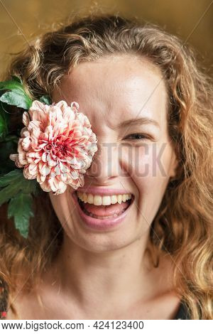 Happy woman with a pip salmon flower