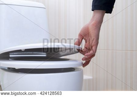 A Hand Open The Toilet Lid, Home Household Sanitary