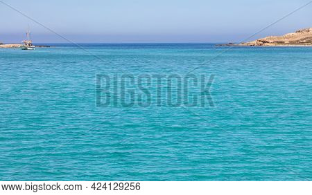 Cyclades Islands, Rinia Bay Clear Transparent Water, Greece. Turquoise Blue Sea, Island Coast And Bl