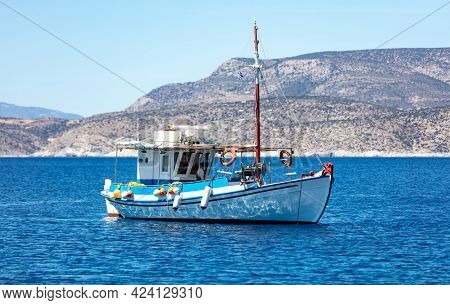 Fishing Boat Colorful Moored At Open Sea, Ios Island Cyclades, Greece.