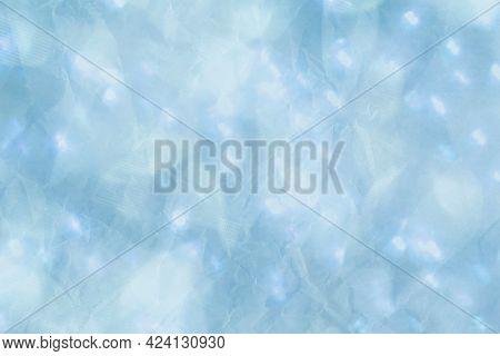 Light blue glitter textured background