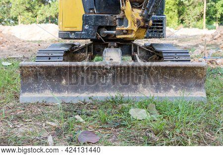 Bulldozer Blade. Blade Bulldozer Standing On The Ground Outdoor.  Snowplow At Tractor.