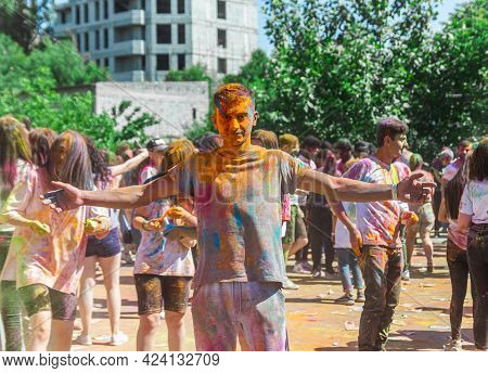 The Pretty Young Boy In The Color Fest, Colored Faces Of The Peoples, Color Festival In India