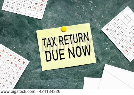 Tax Return Is Now Due. Text On Chalk Board. Black Font