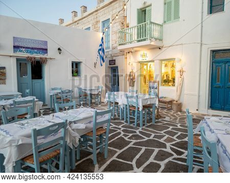 A small Greek tavern at Naoussa Bay on the island of Paros, Greece. May 19, 2021