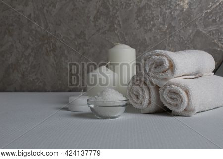 Spa Salon, Spa Treatments. Towels, Candles Salt To Wrap On A Gray White Background With A Place For