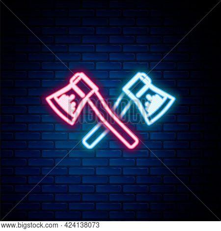Glowing Neon Line Crossed Wooden Axe Icon Isolated On Brick Wall Background. Lumberjack Axe. Colorfu