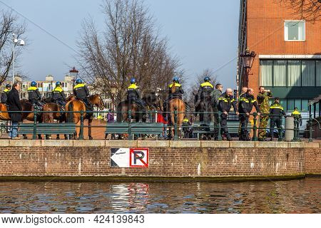 Amsterdam, Netherlands - 12 March 2016: Dutch Police Patrol . Typical Dutch Houses. City View.