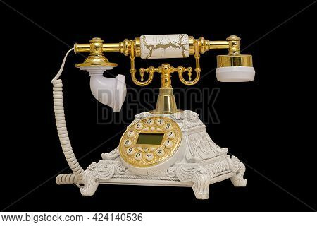 Retro Old Telephone With Receiver And Cord On A Black Background.