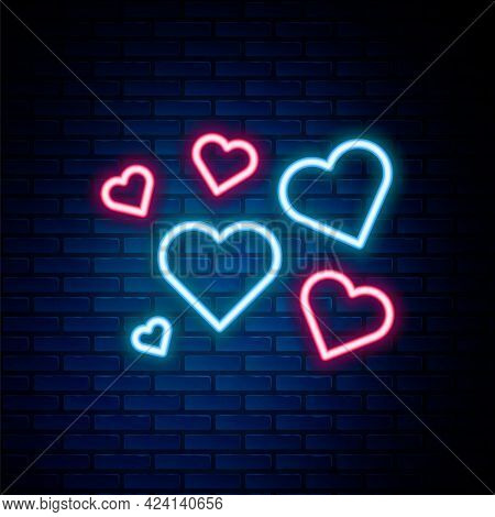 Glowing Neon Line Heart Icon Isolated On Brick Wall Background. Romantic Symbol Linked, Join, Passio