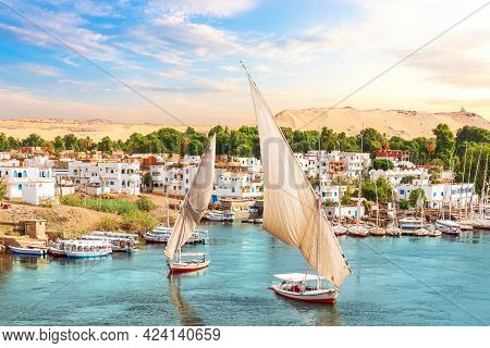 Traditional View Of Aswan, The Nile And Sailboats, Egypt.
