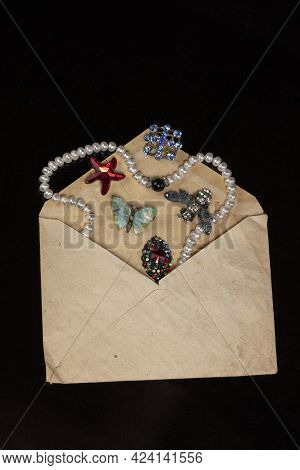 Jewelry, Brooches, Beads Were Poured Out Of An Old Mail Envelope.