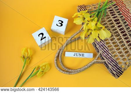 Calendar For June 23: Cubes With The Number 23, The Name Of The Month Of June In English, Yellow Iri