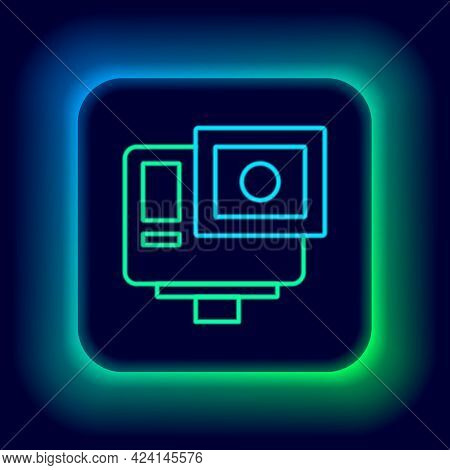 Glowing Neon Line Action Extreme Camera Icon Isolated On Black Background. Video Camera Equipment Fo